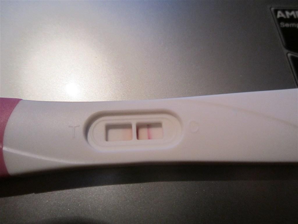 Positiv graviditetstest svag streg